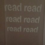"Image projected onto wall that says "" Read read read read"""